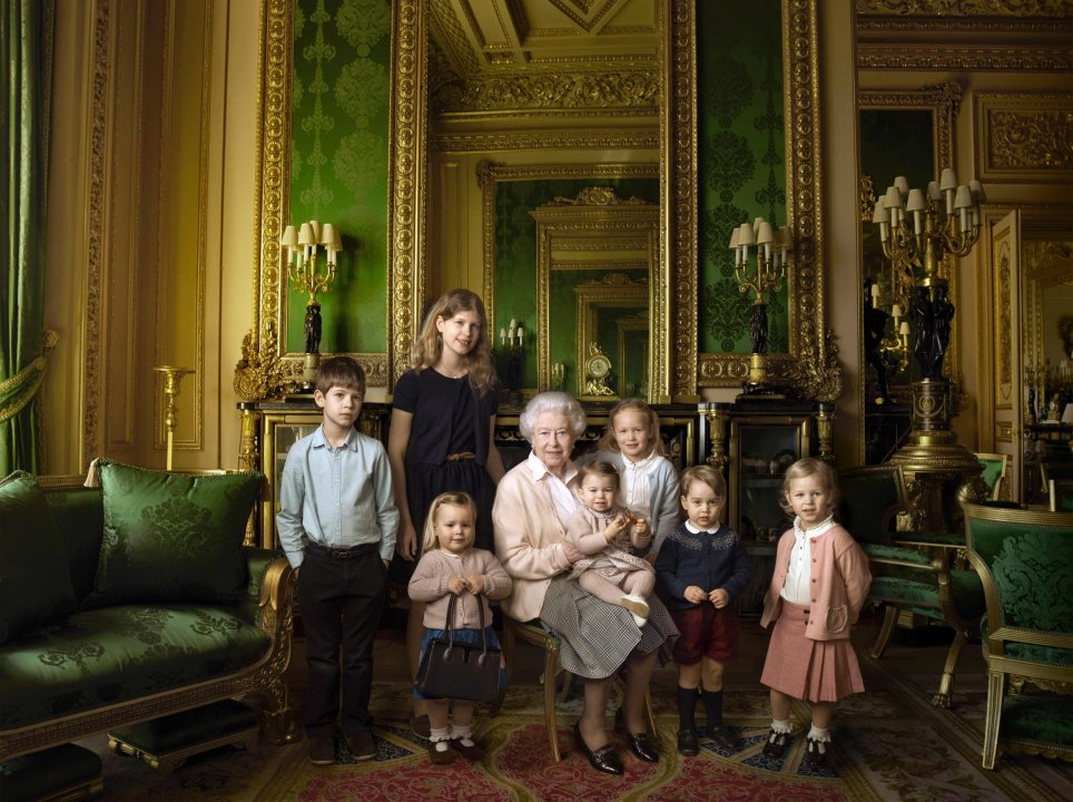 "EDITORS NOTE - EMBARGOED, RELEASABLE ON APRIL 21, 2016 at 0001 GMT - THIS RESTRICTION APPLIES TO ALL MEDIA, INCLUDING WEBSITES This handout portrait picture taken by US photographer Annie Liebovitz shows Queen Elizabeth II (C) posing with her two grandchildren, James, Viscount Severn (L) and Lady Louise (2L) and her five great-grandchildren Mia Tindall (holding handbag), Savannah Philipps (3R), Isla Phillips (R), Prince George (2R) and Princess Charlotte (C) in the Green Drawing room at Windsor Castle in Windsor. This picture is one of three official photographs released by Buckingham Palace to mark Queen Elizabeth II's 90th birthday. / AFP PHOTO / ANNIE LIEBOVITZ / Annie Leibovitz / EDITORS NOTE - EMBARGO, RELEASABLE ON APRIL 21, 2016 at 0001 GMT - THIS RESTRICTION APPLIES TO ALL MEDIA, INCLUDING WEBSITES RESTRICTED TO EDITORIAL USE - MANDATORY CREDIT ""AFP PHOTO / 2016 ANNIE LIEBOVITZ "" - NO MARKETING NO ADVERTISING CAMPAIGNS - DISTRIBUTED AS A SERVICE TO CLIENTS - NOT TO BE USED AFTER MAY 12, 2016 / ANNIE LEIBOVITZ/AFP/Getty Images"